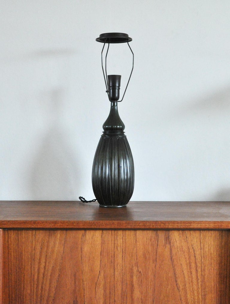Large drop shaped Just Andersen table lamp in disko metal, an alloy of lead and antimony invented by Just Andersen and named after his birthplace the Disko Bay in Greenland.