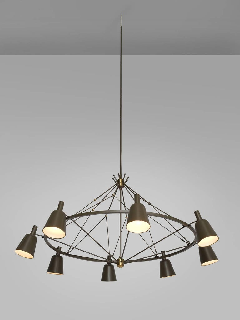 Chandelier, green grey metal, the Netherlands, circa1950.  This large Dutch chandelier is made in the 1950s by a local designer in the Eastern region of the Netherlands. The chandeliers features a thin stem that ends in a brass joint. In the