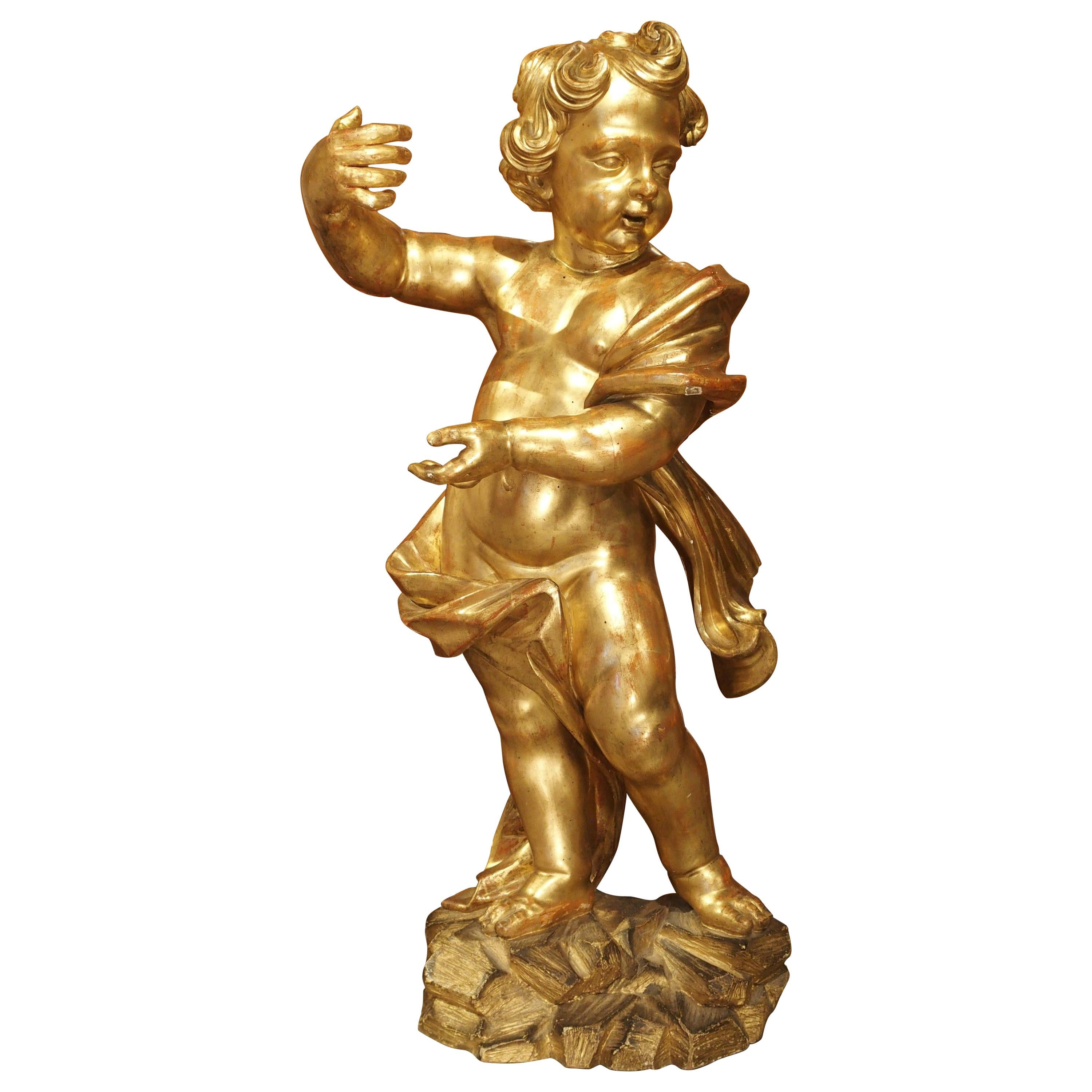 Large Early 18th Century Carved Giltwood Cherub Statue from Italy