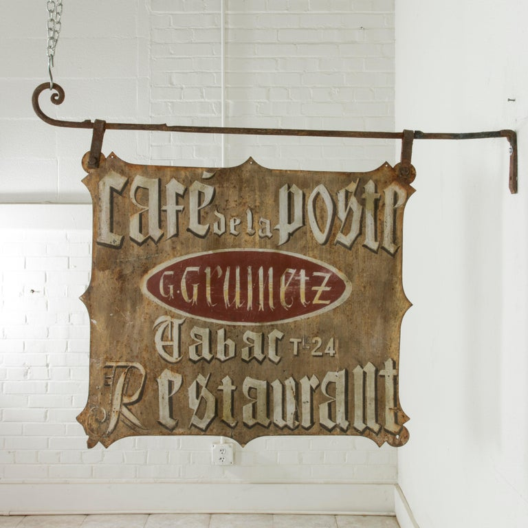 This very large early 20th century French hand-painted iron cafe sign is double faced and is entitled Cafe de la Poste (Post Office Cafe). In the centre on a red background is the name of the proprietor G. Gruinetz. Below his name are the French
