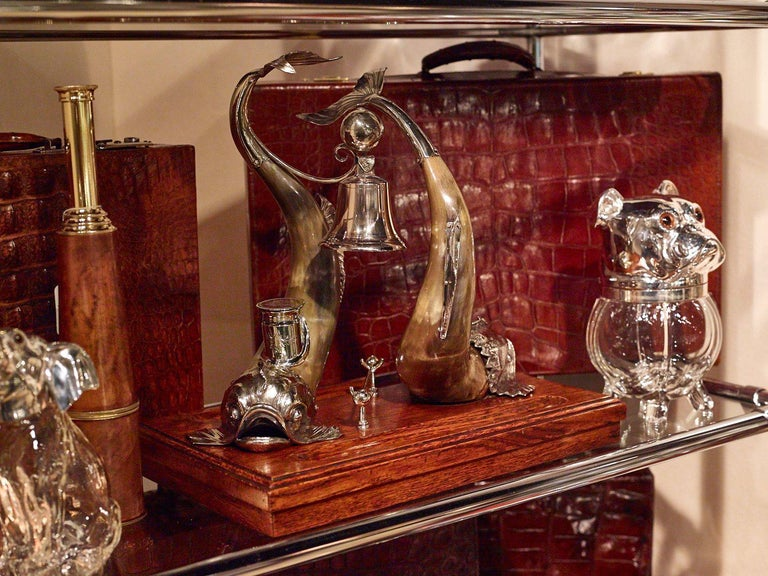 A large and impressive, horn and silver plate partners desk centerpiece, circa 1910. It comprises two superb mythical sea creatures in horn and silver-plate and two hinged lid inkwells.  There is also a bell, which I would imagine was used to summon