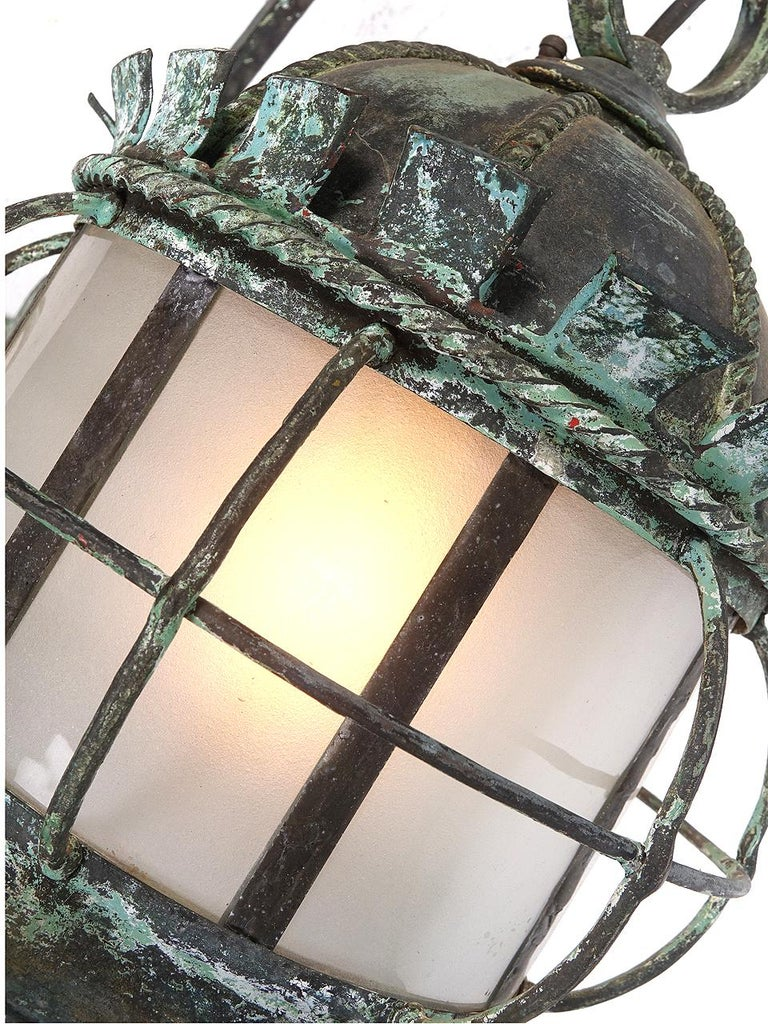 This is an early handmade iron sconce. It was the type of lamp often found over the front entrance of a large estate. In fact this fixture was from the High Top Stone Estate in New York. I believe the estate is long gone and the land it sat on is