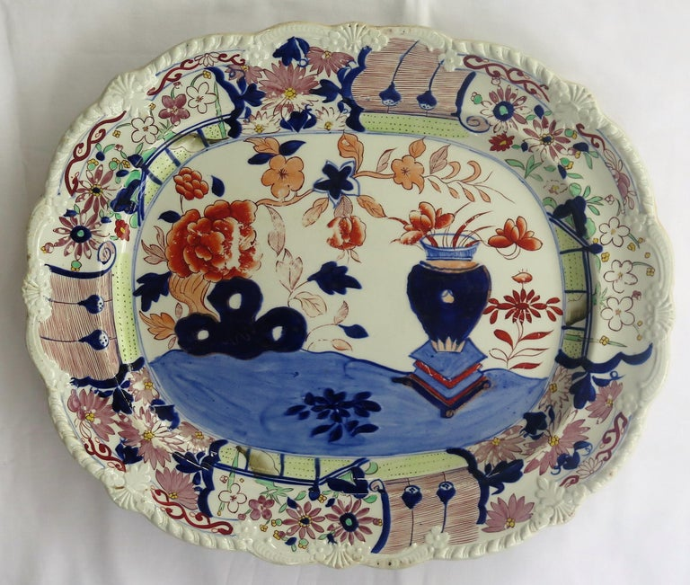 This a large, early 19th century platter of about 18 inch width made by Mason's Ironstone in the Vase and Rock hand-painted pattern, circa 1815.  Very early 19th century Mason's Ironstone platters are rare and this is a Fine heavy example in good