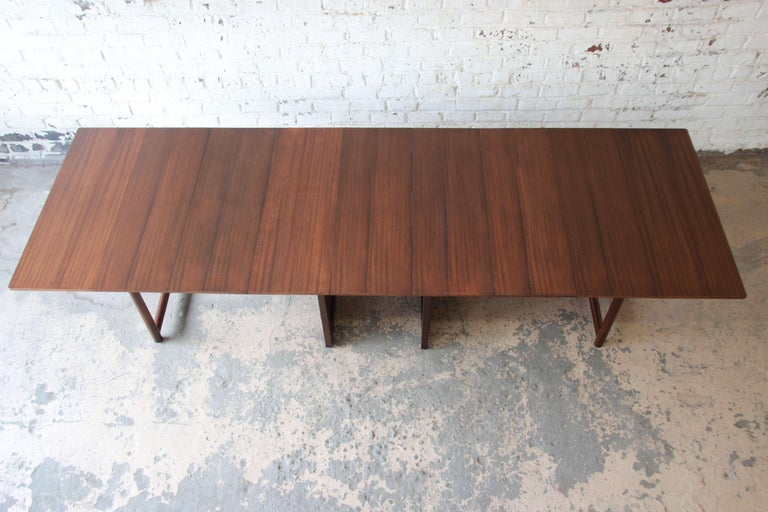 Offering a substantial and amazingly versatile Edward Wormley extension dining table for Dunbar. The table measures at its smallest point 28.5