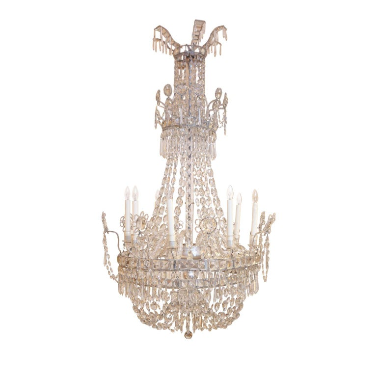 Large eight-light crystal chandelier from Italy, circa 1850-1860. Decorated in crystal prisms, beads and stunning crystal reflectors. Arms are hand blown Murano glass radiating from a glass enclosed silver-gilt metal body. Newly-wired for use within