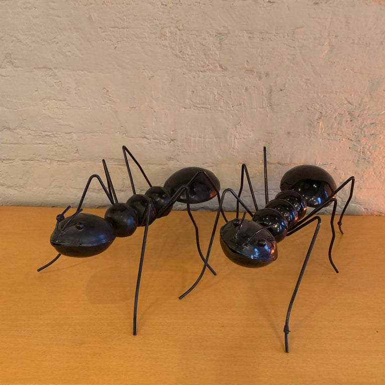 Interesting, enameled steel, ant sculptures are sold separately because they are slightly different; one with a shiny finish and the other a matt finish but they work well as a pair and get very lonely without each other.