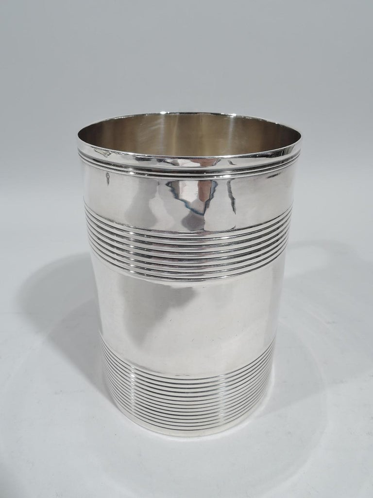 Large English Georgian sterling silver mug, 1795. Straight and upward tapering sides, capped double-scroll handle, and reeded bands. Fully marked including London assay stamp and worn maker's stamp (possibly EB). Weight: 10.9 troy ounces.