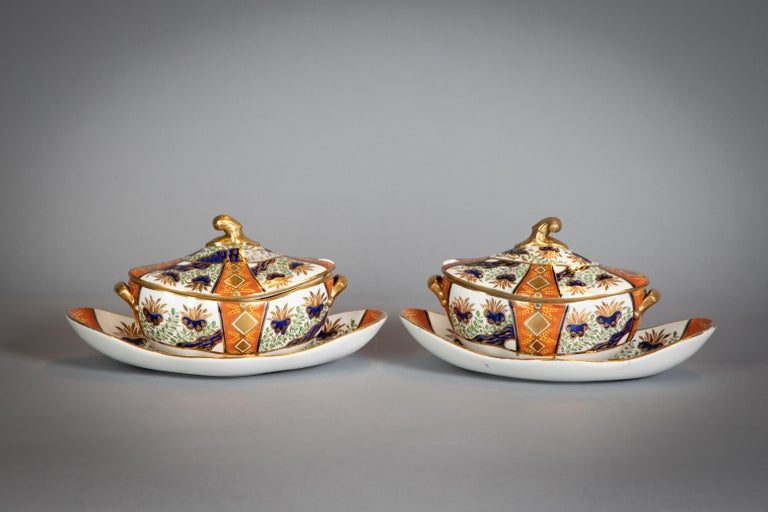 Iron-red uppercase Spode mark and pattern 2213. Richly painted in the Imari palette and enriched in pale-blue, green and gold with flowering shrubs and a tree, the border with alternate radiating panels of the same shrubs and of gilt double diamonds