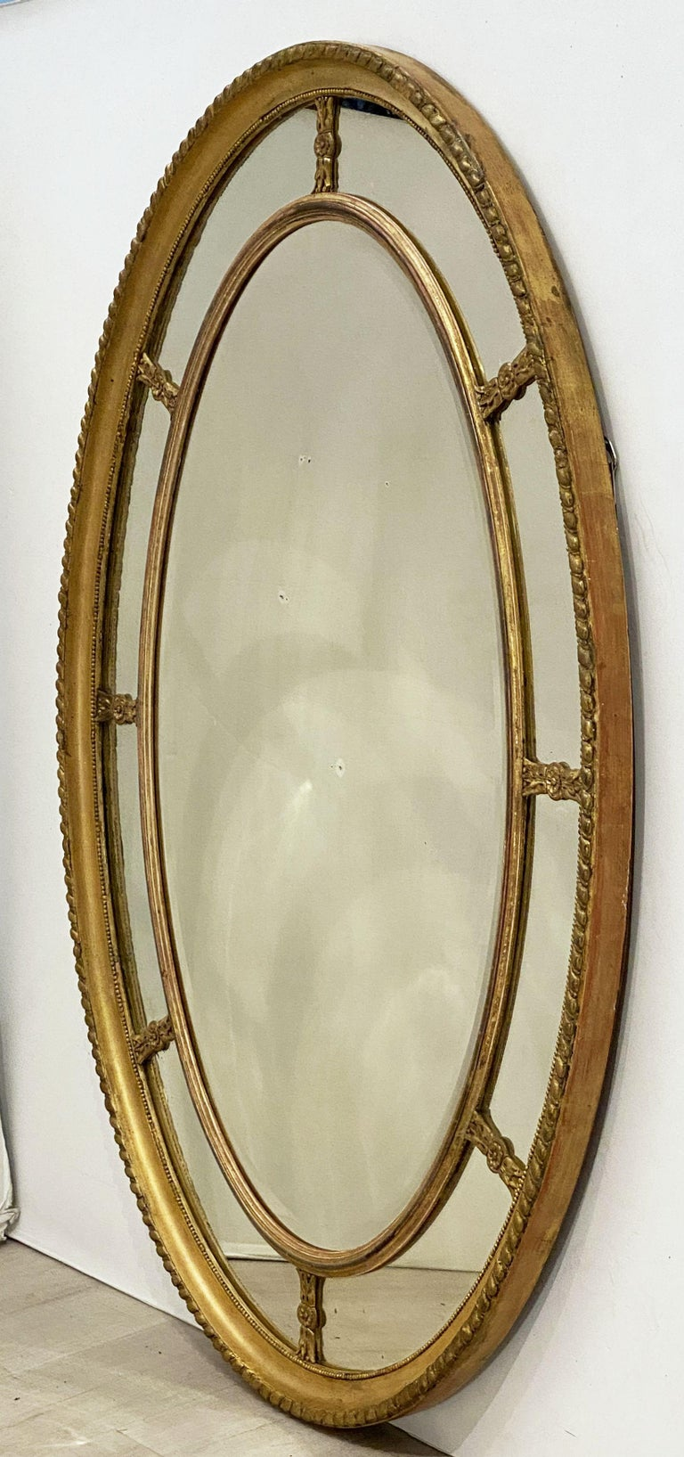 Adam Style Large English Segmented Gilt Oval Wall Mirror For Sale