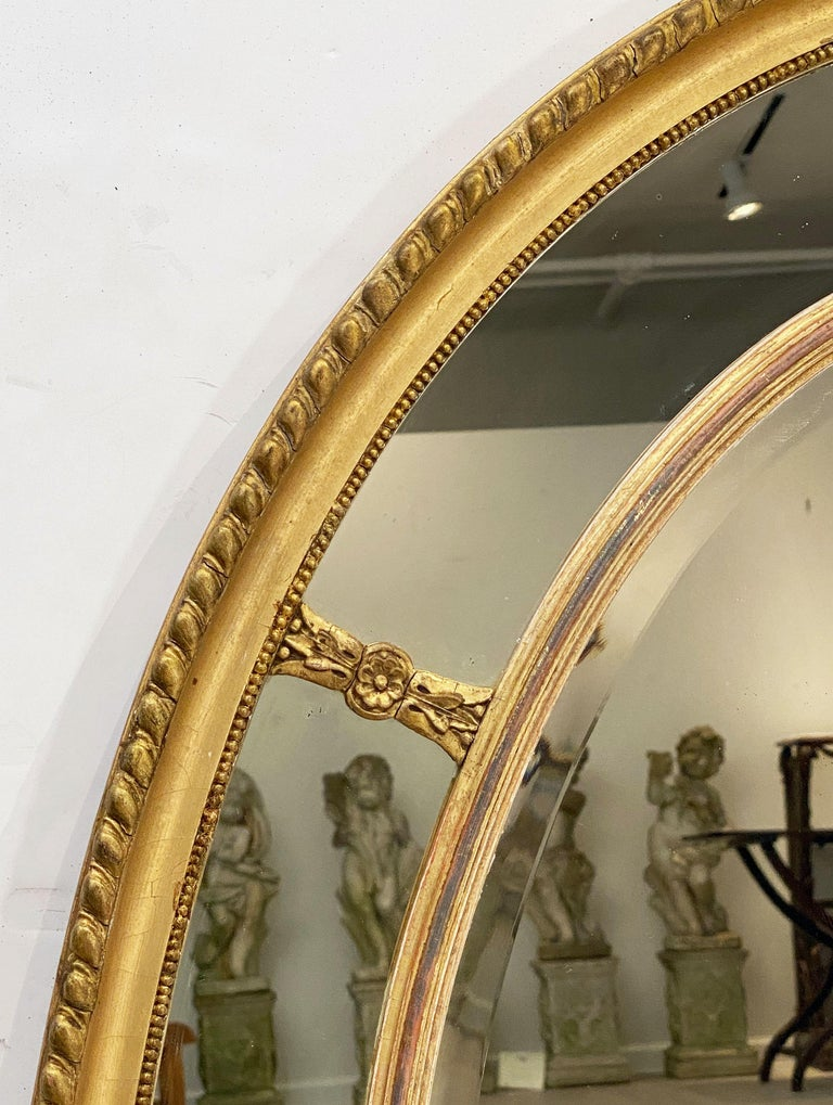 20th Century Large English Segmented Gilt Oval Wall Mirror For Sale