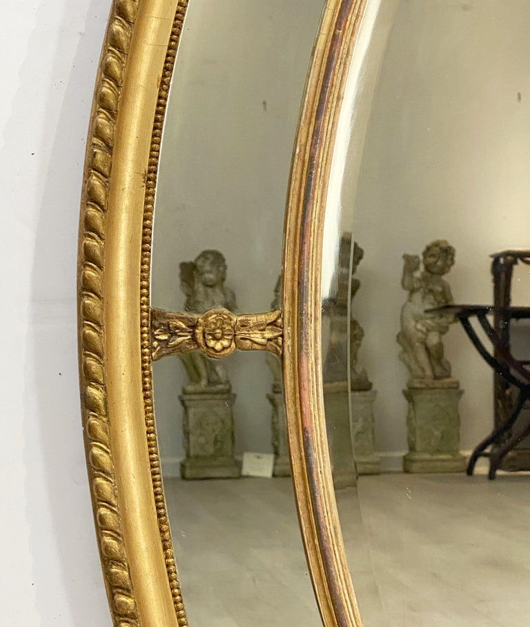 Glass Large English Segmented Gilt Oval Wall Mirror For Sale