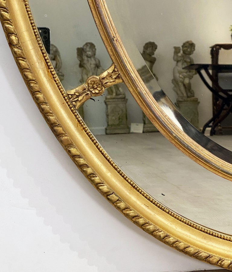 Large English Segmented Gilt Oval Wall Mirror For Sale 1