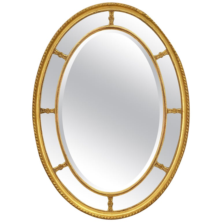 Large English Segmented Gilt Oval Wall Mirror For Sale