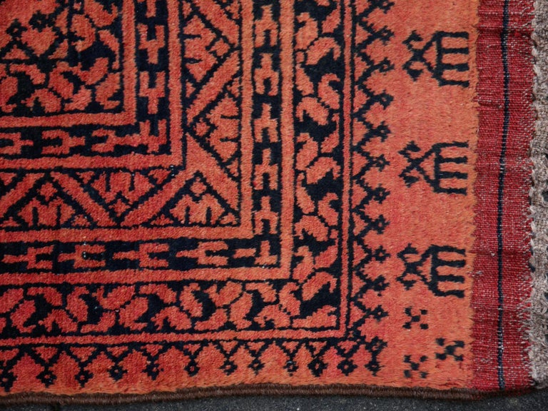 Large sized tribal rug Afghan Ersari Turkoman or Turkmen rug  The Turkmen or Turkoman people are settling in villages in Afghanistan an Turkmenistan near the Persian border. Their origin is tribal nomadic, but most members of the tribes have