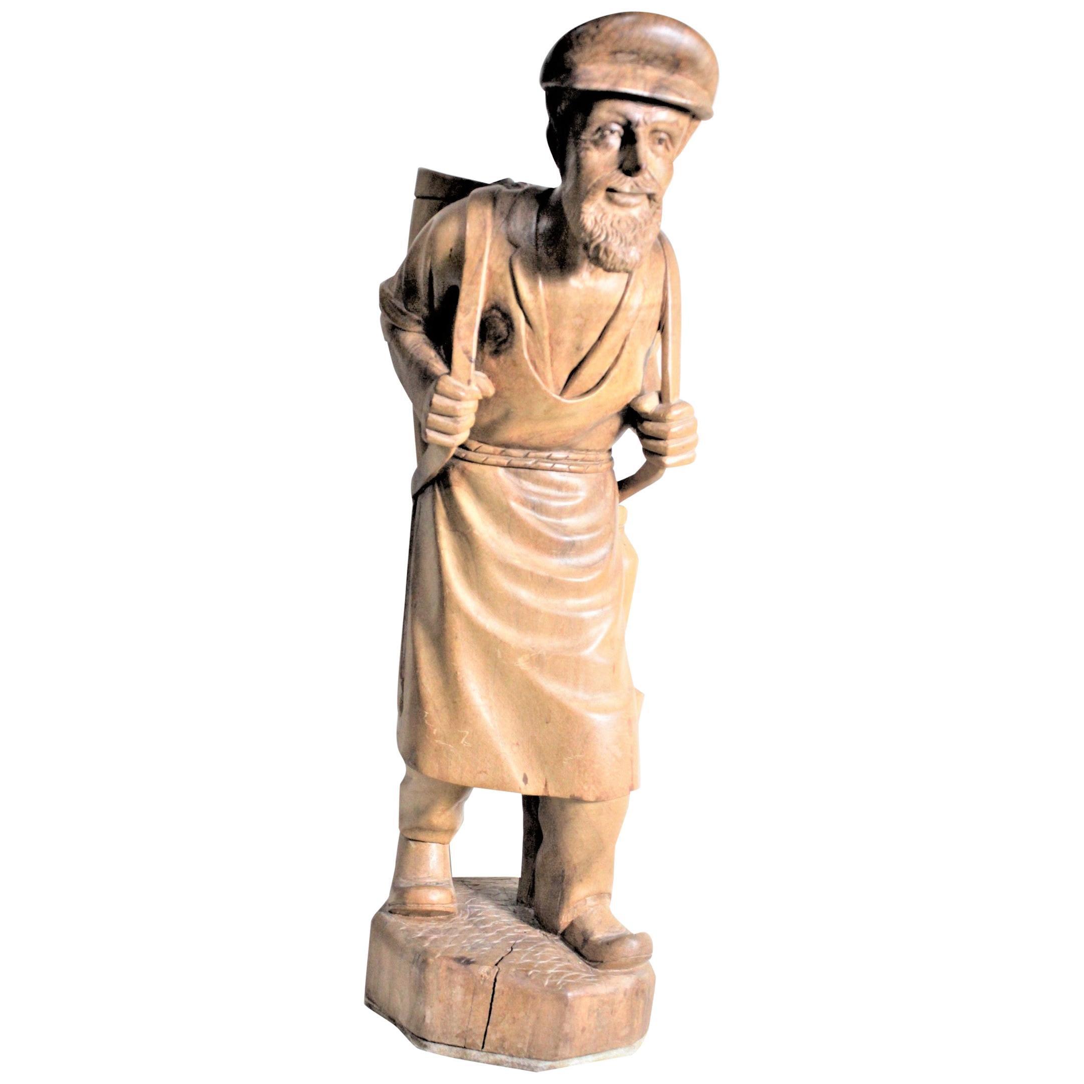 Large European Folk Art Carved Wooden Standing Man Carrying a Basket Sculpture