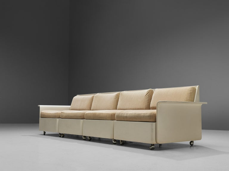 Sectional sofa, lacquered plywood and striped cream fabric upholstery, metal, Germany, 1960s  This versatile sectional sofa is has a clean, modern and rhythmic design. The piece is extendable from 4 parts with a chair to an even larger sofa in 5