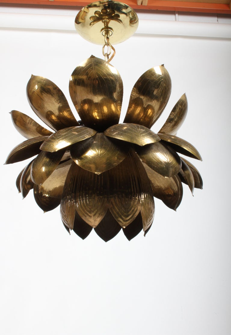 This is the large version of the Feldman Lighting Company's brass lotus chandelier, original brass patina. Three small sockets at top. The lower light uses 1 - 60 watt max
