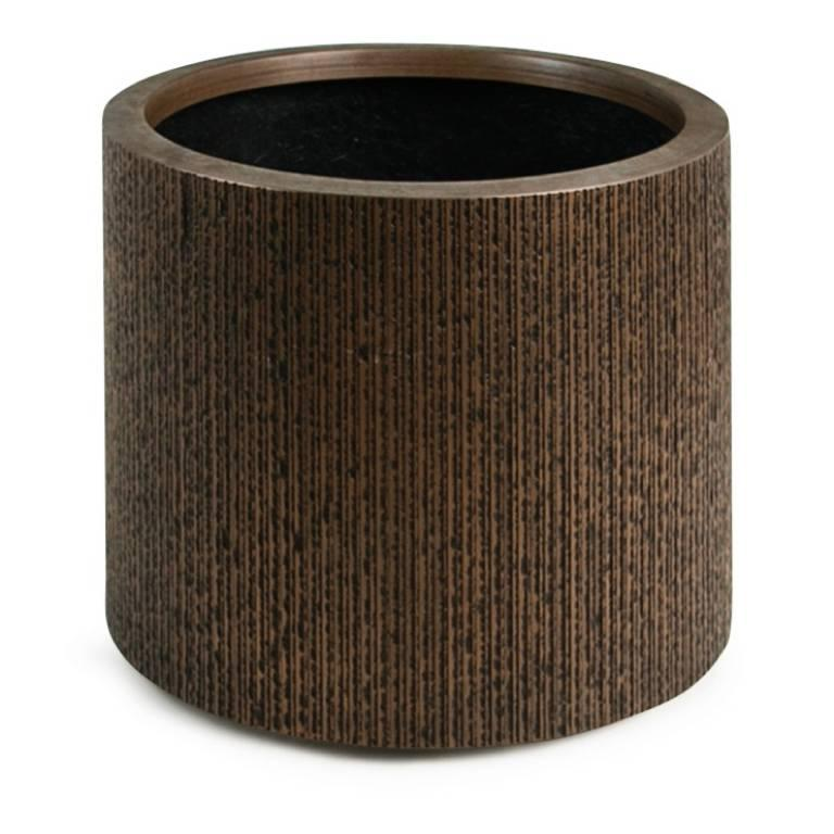 Sizable fiberglass planter by Forms + Surfaces. This impressive piece features scored vertical markings which decorate the bronze colored fiberglass exterior. This large planter is ready for use indoors or out.   This grand plant pot would be a