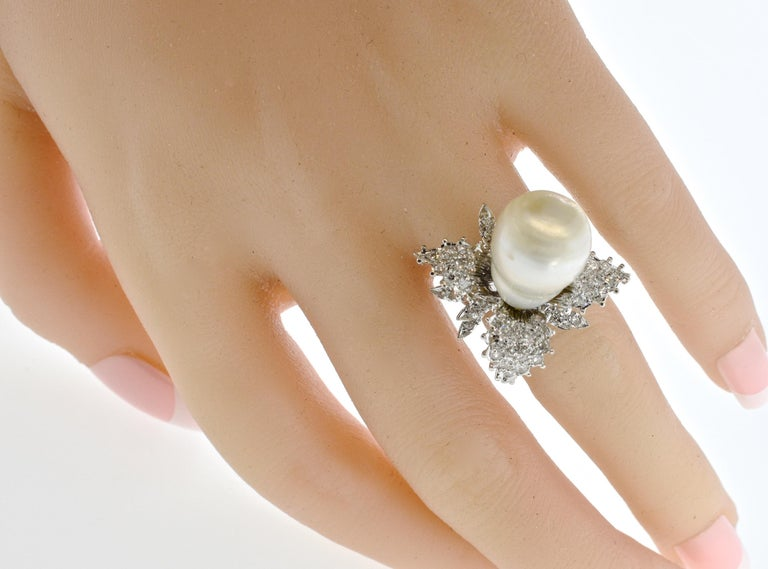 Baroque pearl - large and fine - is set in the center of leaves of  50 white diamonds, pave set in the