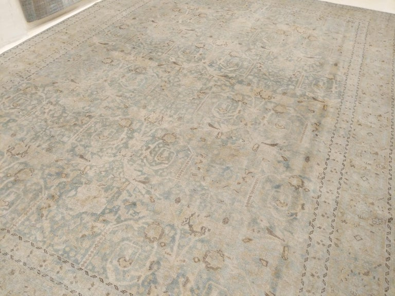 A finely woven old Anatolian carpet of great nobility, distinguished by an infinite repeat pattern of delicately colored palmettes and rosettes floating on an aqua-teal background. One of our most beautiful recent acquisitions in terms of balance