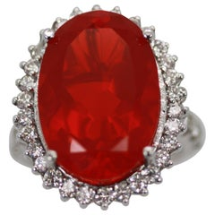 Large Fire Opal 13.0 Carat faceted with Diamond 1.25 Carat Surround
