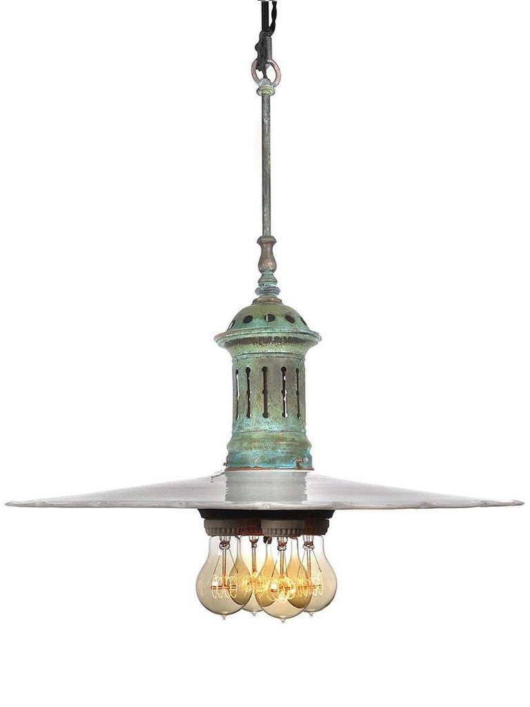 The diameter of these shades are 18 inches. The larger the diameter the harder it is to find. In addition the pair have a unique scalloped edge. We have never found shades like this before. The 4 bulb cluster is by the Benjamin Lamp Company. The