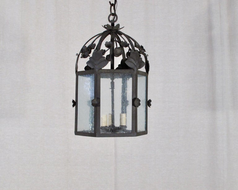 Part of the Chandelier Product Line, this is our floral lantern, Large. This fixture can be used for Interior or Exterior use and is UL Listed. 3' chain included. Three candelabra base bulbs up to 60 watts/socket. Also available in small size. This