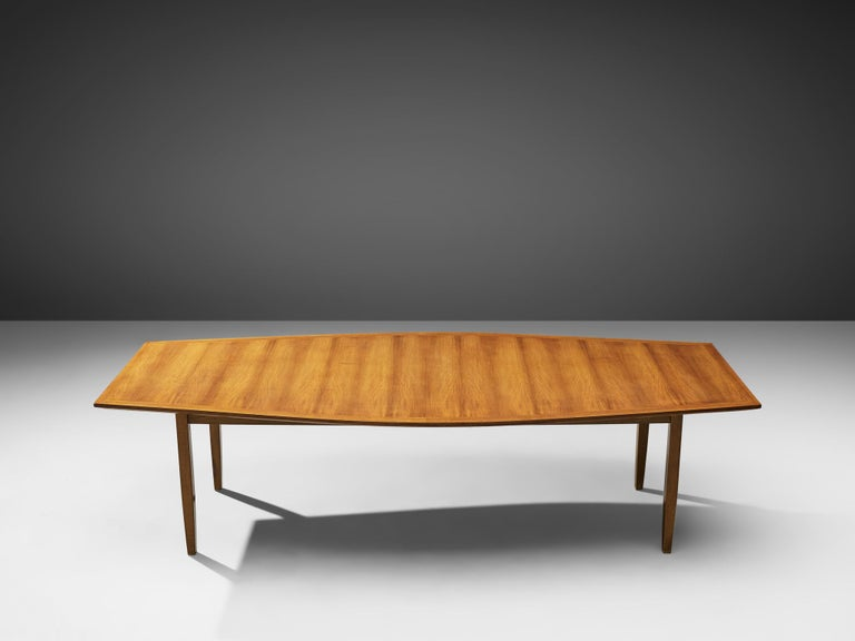 Florence Knoll for Florence Knoll International, large dining table, model 580 H, walnut, United States, 1963. Measures: 8.8 ft.  Large dining or conference table with boat shaped top in walnut. The table has four tapered wooden legs. The top of