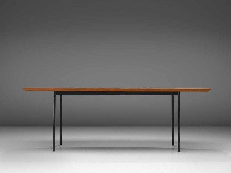 Knoll International, teak, metal, table model 580, United States, 1958-1976.  Large dining table with boat shaped top in teak. The table can seat 8 people. The table has four circular legs. The tabletop features a bevelled, edge, made of a lighter