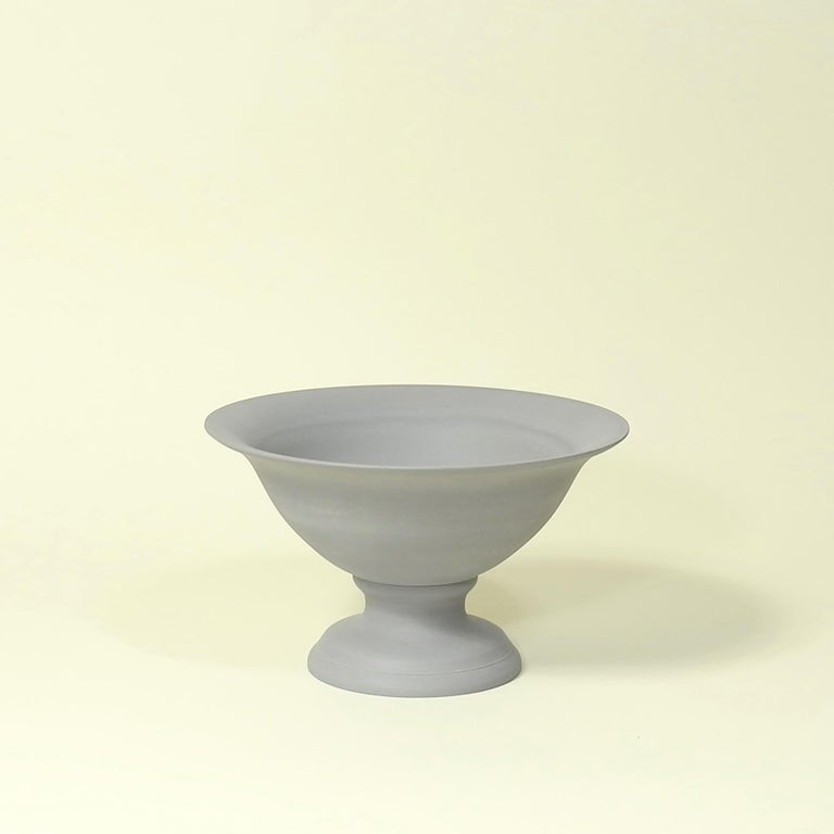 Middle Kingdom garden vaso are modeled after traditional terra cotta wares but are made from pigmented porcelain. The bowl can be moved from the base for planting and watering. The classic, elegant style of this planter belies its supreme