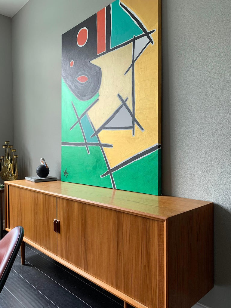 A stunning modern painting by Mak, 2019. The painting features golden hues with green metallic, coral and black.   Would look great in any modern, Mid-Century Modern, or contemporary environment.