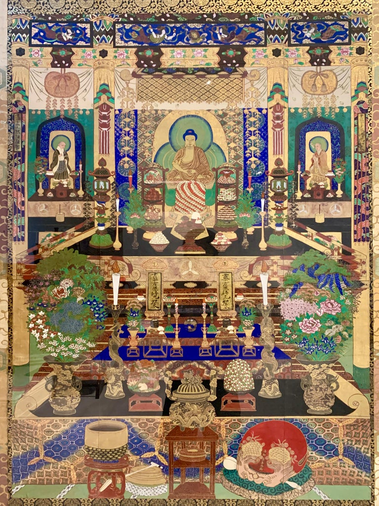 A large and incredible Japanese painting of a Buddhist temple hall with Amida Nyorai, late Edo or early Meiji period, mid-19th century, Japan. Mounted with silk brocade and framed in a heavy, carved and gilt frame.