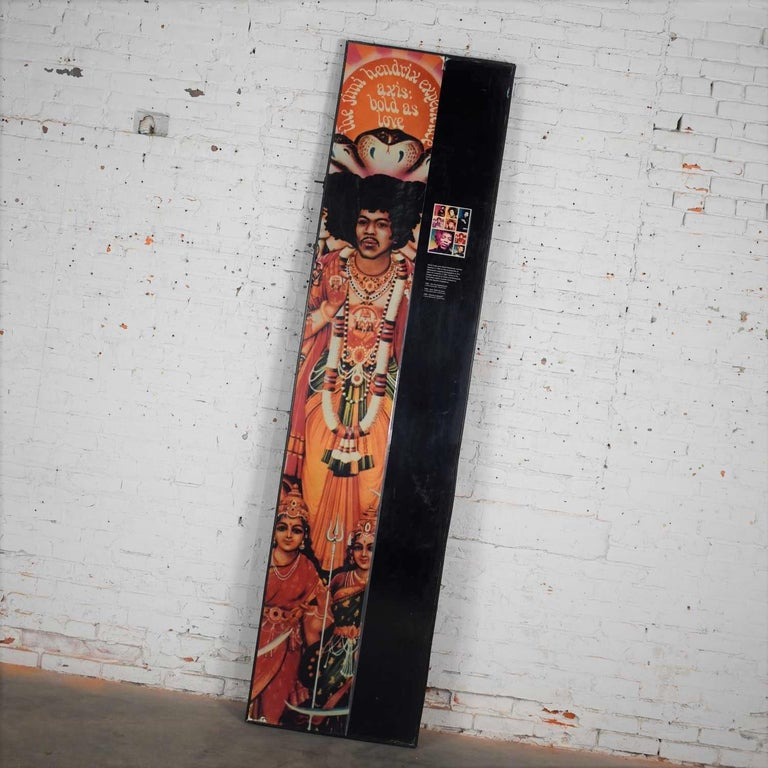 Very cool framed Jimi Hendrix panel that is attributed to a traveling exhibit honoring Jimi Hendrix. This piece is double sided so you can choose the side to display. It is in wonderful vintage condition. There are some signs of age and travel, but