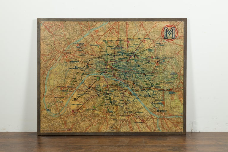 A large French framed map of the Parisian Metro from the mid-20th century, with custom iron frame. Featuring a Paris metro map from the midcentury period, this wall piece is set in a custom iron frame. Showing a nicely worn appearance, the map