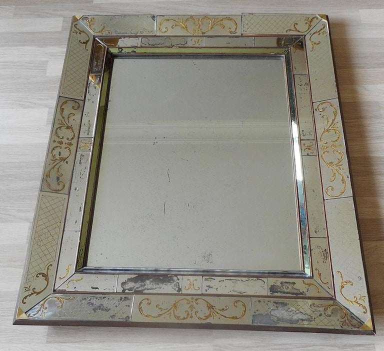 Aged and patinated églomisé mirror, probably made by Max and Paule Ingrand for Jansen, circa 1940.
