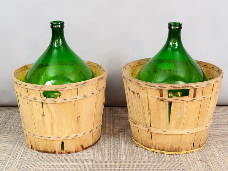 Rustic Large French Antique Emerald Green Demi-John in a Wooden Basket For Sale