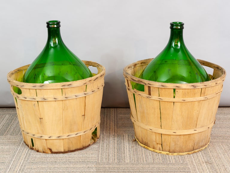 Large French Antique Emerald Green Demi-John in a Wooden Basket In Good Condition For Sale In London, GB