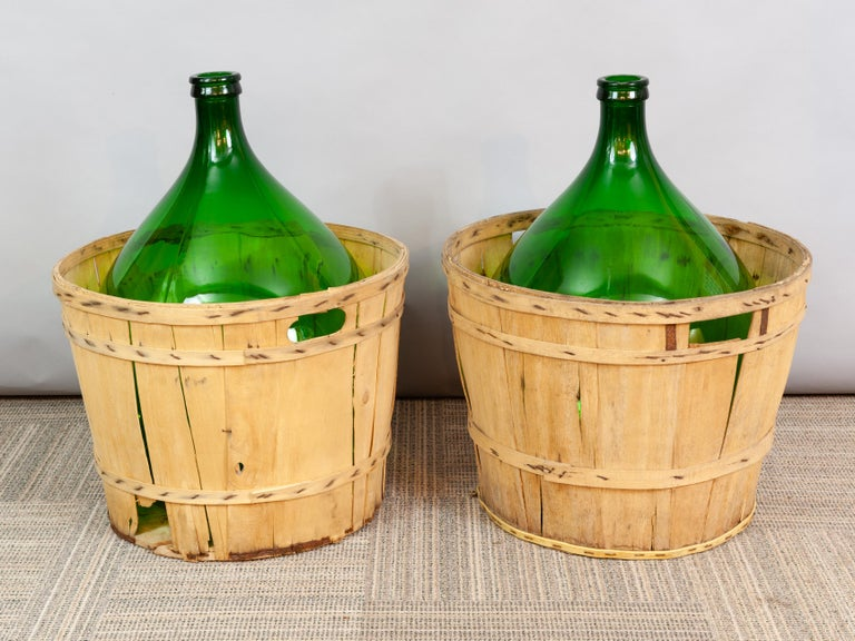 Glass Large French Antique Emerald Green Demi-John in a Wooden Basket For Sale