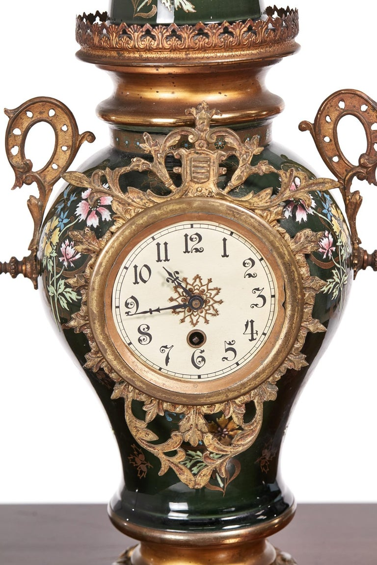 Large French Antique Victorian mantel clock with a wonderfully painted ceramic body and beautiful brass mounts. A very attractive piece in good working order with original key.