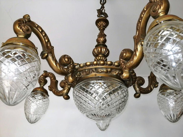 20th Century Large French Art Deco Cut Crystal Globes & Gilt Bronze Ornate Chandelier, 1920s For Sale