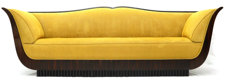 Large French Art Deco gold velvet upholstery grand sofa.
