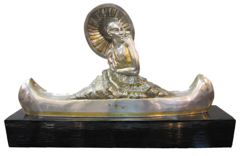 Marie-Louise Simard (French, 1886-1963) A large and important original French Art Deco silver and parcel gilt bronze sculpture of a female figure holding a parasol in a canoe. The figure wears a gilt bodice and a two-tone ruffled skirt, details