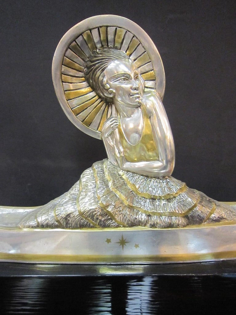 Large French Art Deco Silver and Parcel Gilt Bronze Woman in Canoe, M.L Simard In Good Condition For Sale In New York City, NY