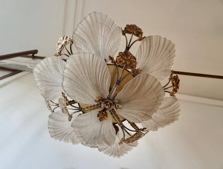 Art Nouveau style chandelier or flushmount with petal or shell shaped frosted glass and leaf design in brass.