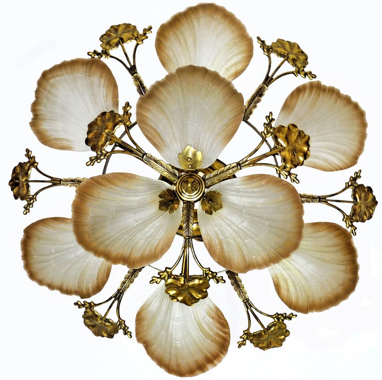 Art Nouveau style chandelier or flush mount with petal or shell shaped frosted glass and leaf design brass Measures: Diameter 80 cm Height 30 cm Weight 12 Kg / 28 lb Nine-light bulbs E14 good working condition Assembly required. Bulbs not included.