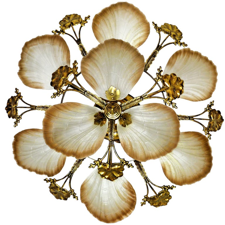 Art Nouveau style chandelier or flush mount with petal or shell shaped frosted glass and leaf design brass Measures: Diameter 80 cm Height 30 cm Weight 12 Kg / 28 lb Nine-light bulbs E14 good working condition Assembly required. Bulbs not