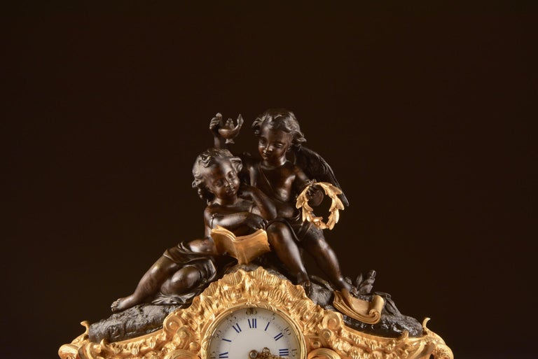 Large bronze double-figure mantel (fireplace) clock by famous French clockmaker (Guiche Palais Royal, 147) with two beautiful reading cherubs.