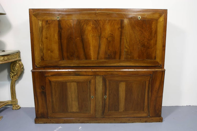 This French Directoire traveling secretary is made of walnut. Its large size is unusual and would make an impressive statement in a study. The top section of the secretary is period, dating from the end of the 18th century, while the base was