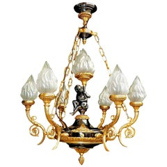 French Empire Cherub Patinated and Gilt Bronze 7-Light Putti Torch Chandelier