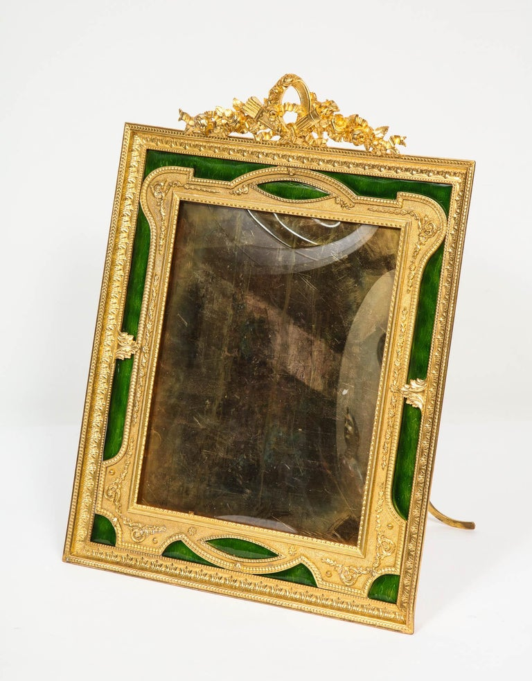 A beautiful and large French gilt bronze ormolu and green Guilloche enamel antique picture photo frame, circa 1895.